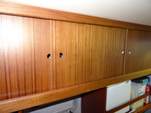 We added a doors to the shelving on the port side between the stateroom and the head.
