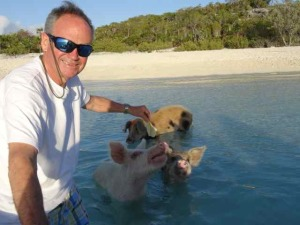 Tim feeding the pigs on Piggy Beach near Staniel Cay.