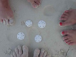 Toes in the sand at the Atlantic Beach on Shroud Cay