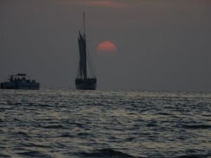 A Conch Navy vessel sailing in to the sunset